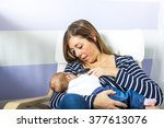 a mother breast feeding his... | Shutterstock . vector #377613076