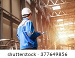builder in hard hat looking at... | Shutterstock . vector #377649856