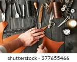 man working with leather using... | Shutterstock . vector #377655466