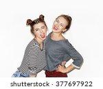 Two Cheerful Beautiful Girls...