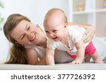 happy crawling baby girl with... | Shutterstock . vector #377726392