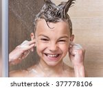 happy boy takes a shower in the ... | Shutterstock . vector #377778106