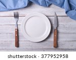 Empty Plate On Tablecloth On...