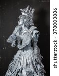Silver Statue In Old Dress Wit...