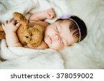 newborn baby girl sleeps... | Shutterstock . vector #378059002