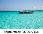 boat in cayman island's crystal ... | Shutterstock . vector #378072166