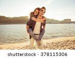 happy young man piggybacking... | Shutterstock . vector #378115306