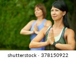 two mature women keeping fit by ... | Shutterstock . vector #378150922