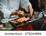 chef making kobe sushi on boat  ... | Shutterstock . vector #378264886