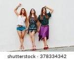 alluring smling girlfriends | Shutterstock . vector #378334342