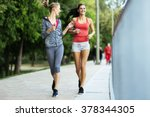 fit women jogging outdoors and... | Shutterstock . vector #378344305