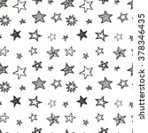 Hand drawn stars doodle seamless pattern. Hand drawn ink illustration. Simple background with stars for decoration.