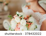 wedding bouquet in hands of the ... | Shutterstock . vector #378432022