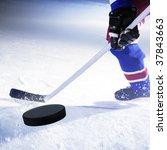 Ice Hockey Player Shoots Puck