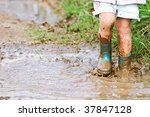 child's feet stomping in a mud... | Shutterstock . vector #37847128