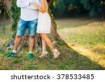 female and male feet on grass | Shutterstock . vector #378533485