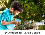 young thai boy spray water to... | Shutterstock . vector #378561595