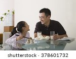 father and daughter sat at a... | Shutterstock . vector #378601732