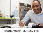 man doing accounts in cafe | Shutterstock . vector #378657118