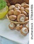 Small photo of Agaricus bisporus - Fresh raw mushroom champignon wicker baskett (brown mushroom)