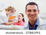 friendly male dentist in his... | Shutterstock . vector #37881991