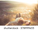 carefree happy woman lying on... | Shutterstock . vector #378999655