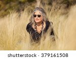 fifty year old woman in outdoors | Shutterstock . vector #379161508
