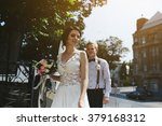 bride and groom posing on the... | Shutterstock . vector #379168312