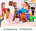 teacher with kids read and... | Shutterstock . vector #379181695