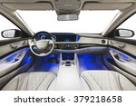 Car interior luxury. Interior of prestige modern car. Leather comfortable seats, dashboard & steering wheel. White cockpit with exclusive wood & metal decoration on isolated white background. - stock photo
