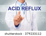 Small photo of Doctor hand touching acid reflux sign on virtual screen. medical concept