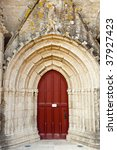 Red Ornate Church Door In...