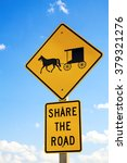 Small photo of A road sign warning drivers to share the road with the local Amish horse and buggies.