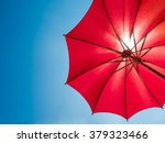 Red Umbrella On Sunny Blue Sky...