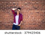 young man wearing a check shirt ... | Shutterstock . vector #379425406