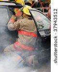 fireman at the scene of a car...   Shutterstock . vector #37943512