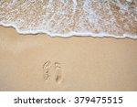 Footprints On Sea Shore. Sea...