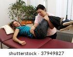 physiotherapist doing her job   Shutterstock . vector #37949827