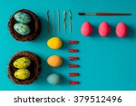 Flat Lay Of Easter Eggs On Blu...