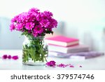 Stock photo beautiful flowers in vase on table in room 379574746