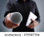 hand holding a microphone... | Shutterstock . vector #379587706