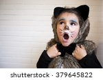 Girl With A Cat Costume In...