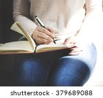 asian lady writing notebook... | Shutterstock . vector #379689088
