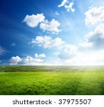 field of spring grass and sunset | Shutterstock . vector #37975507