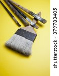 old brushes on yellow background | Shutterstock . vector #379783405