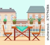 table and chairs on the balcony.... | Shutterstock .eps vector #379796386