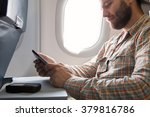 person sitting inside airplane... | Shutterstock . vector #379816786
