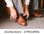 a close up of a groom tie the... | Shutterstock . vector #379818982