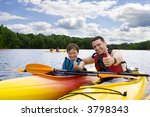 father and son enjoying kayaking | Shutterstock . vector #3798343