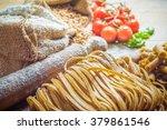 pasta tubes and tagliatelle... | Shutterstock . vector #379861546